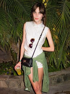 93e8721677cd music festival outfit idea  Alexa Chung at Coachella wearing a striped  short sleeve shirt and matching shorts with an army green jacket and  crossbody bag