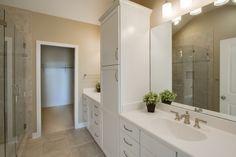 Master en suite bath. White Shaker cabinets. Brushed nickel hardware and plumbing fixtures. Ceramic tile floors.