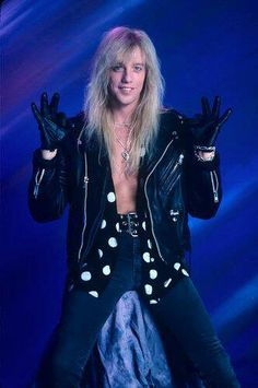 Jani Lane - Warrant   (But be honest @Design Unlimited White, it looks like he is pooping a towel.)