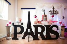 """Black Paris cutout with the Eiffel Tower """"A"""" from a Paris 10th Birthday Party at Kara's Party Ideas."""