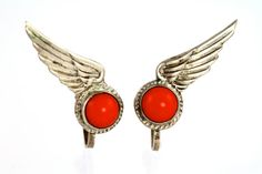 Vintage 925 Sterling Silver screw back earrings that were made in Mexico.  In the design of wings each is set with a red stone that I think is