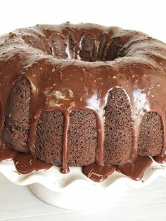 Triple Chocolate Fudge Bundt Cake You won't believe how easy this triple chocolate fudge bundt cake is to make. Starts with a boxed Chocolate Pumpkin Cake, Milk Chocolate Ganache, Chocolate Fudge Cake, Chocolate Topping, Instant Pudding, Box Cake Recipes, Bunt Cakes, Breakfast Cake, Vegetarian Chocolate