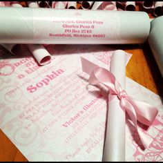 Pretty pink princess 1st birthday party invitations by Lepenn Designs. Scroll style accented with ribbon and mailed in tubes with custom address labels. #invitations