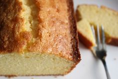 Classic Lemon Pound Cake - Butter, tender and moist cake with a golden crust and topped with a tangy lemon glaze. Great for a tea time snack