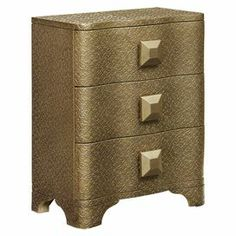 """3-drawer chest in champagne with scrolling details and oversized pulls.   Product: ChestConstruction Material: Engineered woodColor: ChampagneFeatures:  Three drawersOversized hardwareDimensions: 31"""" H x 24"""" W x 14"""" D"""