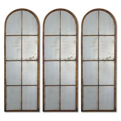 This decorative wall mirror will add an antique or rustic flair to your home. Featuring a durable metal base with an attractive maple-brown finish, this rectangle mirror has an arched top for added style and is sure to stand out in any room.