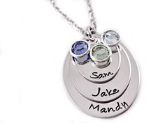 This listing includes three layered hand stamped stainless steel ovals. The largest of the ovals measures 1 x 1 1/4. Also includes three Swarovski