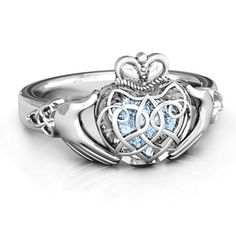 This Irish and Celtic inspired spin on our Caged Hearts Ring is full of meaning and love! The three-dimensional heart, with Celtic detailing features heart-shaped cut outs which reveal two or three (your choice), loose heart-shaped stones inside representing you and your loved ones being safe and protected with one another. In true claddagh fashion, the traditional Celtic crown symbolizes loyalty, the hands symbolize friendship and the heart represents love.
