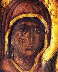 The Stabbed Icon of Panagia Esfagmeni at Vatopaidi Monastery *** It is told of this 14th century icon that it was damaged by the knife of a malcontent deacon-monk.From the wound which he inflicted, blood flowed and the face of the Virgin is said to have turned pale. The deacon was immediately blinded and fell to the ground, beating himself and driven out of his senses. He remained in this state for three years until Theotokos cured him, but his sacrilegious hand stayed black forever.