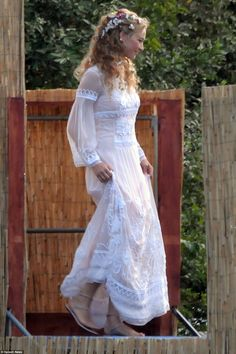 Bridal beauty: Beatrice, 29, slipped into an elegant floor-length embroidered ivory dress and kept her look casual with silver gladiator sandals 31 Jul 2015