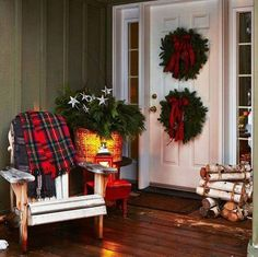 I love the idea of two wreaths!  Very cozy front porch!  #porch #lovethis #christmas #decor #diy #wreath #plaid #lights #outdoors #cozy #inviting #charming #peaceful #home #ideas #inspiration #outside #frontporch #entrance #welcome