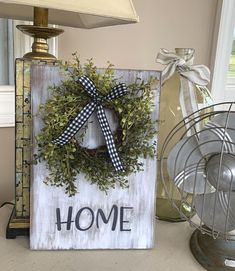 """$50 · NEW TO OUR SHOP!!! This is quite possibly our prettiest sign!! It's made from real pine wood boards. The sign is chalk painted, distressed and the words are hand painted! I also make every wreath. Each sign will be different and unique. Please allow 1-2 weeks. We can custom!!! Message us for more details!! Check out our FB page and our Instagram!! We a lot of times offer deal of day...sometimes """"bundle"""" deals!!! Dimensions for sign 11x16in and Wreath is 10in (these are approximate)"""