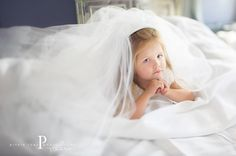 take a photo of your daughter in your wedding dress and display it at her wedding! I can't wait to do this