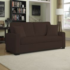 The Portfolio Home Furnishings Mona SoFast sofa features transitional track arms with bench seating and can be assembled with ease. The comfortable sofa is covered in a bark brown chenille fabric and includes two matching throw pillows.