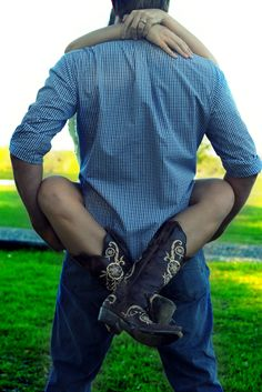 Engagement Picture: BEST WAY TO DISPLAY THE BOOTS!!!!!! =D  AWWWW KEY TO MY HEART<3
