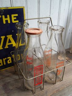 I lucked into this find yesterday :) 3 bottles only but got the basket too Old Milk Bottles, Vintage Milk Bottles, Milk Cans, Bottles And Jars, Milk Jug, Glass Bottles, Milk The Cow, Churning Butter, Antique Decor