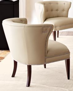 Global Views Creamy Leather Scoop Chair Creamy beige cowhide chair with curved, tufted back and polished nickel nailheads rests on birch legs with a dark walnut finish. Each chair has eight-way, tied