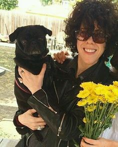 With a dog and flowers