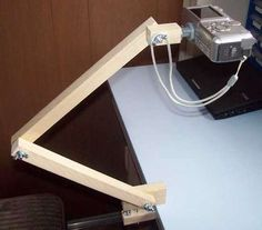 Make your own over head camera mount. <-- Good for turning books to PDF, or converting old photographs to digital.
