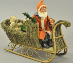 Germany, magnificent lichen moss sleigh, seated in front is composition Santa, red felt coat with blue collar, Santa . on May 2016 Antique Christmas, Primitive Christmas, Christmas Items, Christmas Holidays, Christmas Ornaments, Christmas Wreaths, Merry Christmas, Xmas, German Christmas Decorations