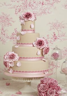 Latte/deep champagne color wedding cake with dusty pink, blush, and deep mauve accent roses. Cake by Peggy Porschen.