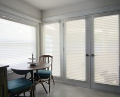 Hunter Douglas Silhouette shades or interior doors and a dining room window.