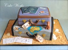 Australia themed luggage cake - This was such a fun non-traditional wedding cake to make. The bride and groom are moving to Australia. The reception was themed as a send off to their new adventure. Their beloved dog is going with them so she was also included on the cake.