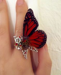 Steampunk ring, butterfly ring, red ring, silver steampunk, filigree ring, boho ring,  magic ring, watch gear ring. $50.00, via Etsy.