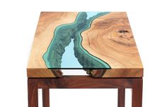 Furniture maker Greg Klassen brings the beauty of the Pacific Northwest indoors with River Collection, a series of reclaimed wood tables embedded with river-like glass inlays.