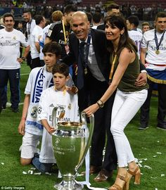Zidane poses with sons Elyaz and Theo, and wife Veronique, alongside the European Cup