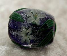 Akihiro Okama lillies, he's very well known for this type of bead. It took me a couple of years but i was able to purchase one like this. 2006