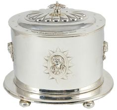 Silver Plated Cookie Jar or Tea Caddy with Cameos English 19th Century I think a person could make something similar using a tin like cookies come in, a silver plate and some odds and ends for the craft store and polish it off with some silver paint.