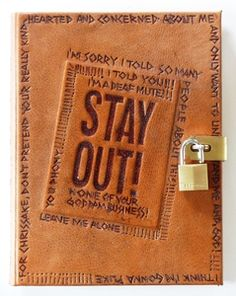 """The Catcher in the Rye by J.D. Salinger, bound by Richard Tuttle. Rebound in pig leather covered boards w/ elaborate tooling to front board & spine expressing views from the book. Front endpapers are an elaborate combination of a detective magazine similar to one Holden took on the train w/ him & other period memorabilia he might not want his mother to see. Final touch is a padlock to ensure that the diary is not opened by unwelcomed eyes. 2012, 11"""" x 9""""."""