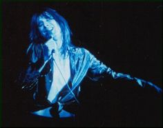 Steve Perry (Journey) One of the best voices in history. Love him.