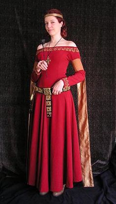 Lady's red cotehardie: First variation of this kind of dress with gold embroidery and brown tippets (14th century). It is based on picture of Viollet le Duc (Encyclopedie medievale). Similar picture is also in Eduard Wagner's Medieval costume, armour, and weapons.