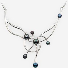 Sterling silver asymmetrical pearl necklace with long silver links and a modern abstract sterling silver focal piece set with freshwater black pearls. https://zanfeldjewellery.com/wholesale/necklaces/sterling-silver-asymmetrical-pearl-necklace/