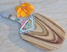 This beautiful serving board is lovingly handcrafted by Millie from reclaimed campha timber.It is handpainted and sealed to protect the painted surface.Whether you use it to serve cheese,dips,antipastos, fruit,breakfast or even dinner, this beautiful campha timber board will present your favorite foods with a unique style and organic simplicity.  The original  Entirely handcrafted + handpainted by Millie Fairhall  One of a kind   Strong.Durable.Versatile  Bur...