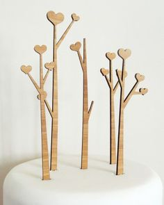 Why have just one cake topper when you could have a forest of them?  (Cabin + Cub Heart Trees Cake Topper Set, $40)