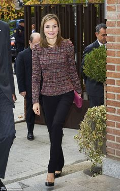 Queen Letizia was pretty in plum today as she stepped out in the Spanish capital of Madrid...
