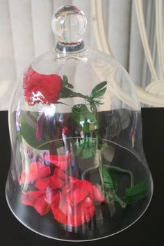 The falling rose.  Used a silk rose, real petals & a cheese glass dome.