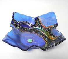 Opal Moon Flared Bowl by Karen Ehart. Rivers of *dichroic:dichroism* glass in many layers and mosaic-like chips of colorful *iridized:iridized glass* and dichroic glass flow through this *fused:fused glass* and *slumped:slumped glass* glass bowl with gold pen work. No two pieces are alike, each are individually designed.