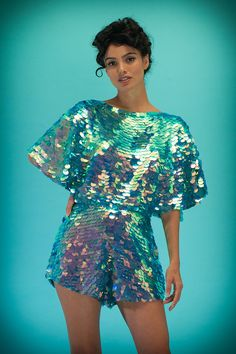 Iridescent sequins hand-stitched onto a fine woven rayon voile base. Hidden zip at the back, and pockets. Not sure which size is right for you?...