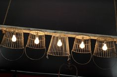 Light fixture:  reclaimed barn wood and wire baskets.  I would LOVE this over my dining room table!