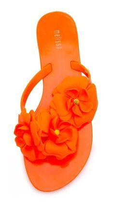 4bdce3de4eccca fun orange floral flip flops Orange Flip Flops