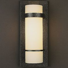 This traditional wall sconce from Hubbardton Forge brings contemporary style to any living area. Uses one maximum 100 watt BT bulb (not included). Style # 16657 at Lamps Plus. Outdoor Wall Sconce, Wall Sconce Lighting, Candle Sconces, Outdoor Lighting, Wall Sconces, Lighting Ideas, Bathroom Lighting, Bathroom Sconces, Exterior Lighting