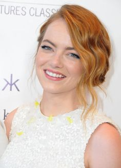 Emma Stone really knows how to light up a red carpet! The stunning actress was all smiles at the premiere of Irrational Man, posing for pictures and hugging her costars.