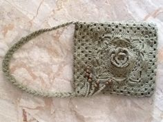 oliv crochet bag decorated with a flower