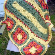 Wildflower Crochet Granny Square Blanket | This crochet granny square afghan is made up of different colored granny squares for a unique patchwork effect