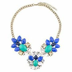 Add a pop of style to evening ensembles and work outfits alike with this stunning gold-plated necklace, showcasing clusters of faceted blue beads and shimmering rhinestones.