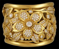 """A diamond and gold cuff bracelet, by Barry Kieselstein-Cord. The openwork sculpted 18kt. gold hinged cuff designed as a cluster of circular-cut diamond flower blossoms, mounted in 18kt. gold, 2003, 2 1/4"""" diameter, Signed B.Kieselstein-Cord."""